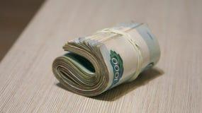 Punhado torcido do dinheiro, embalagem da c?dula imagem de stock royalty free