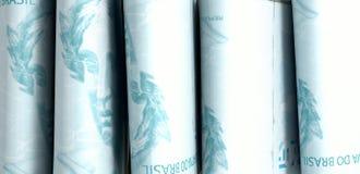 Punhados da luz da pilha das notas Fotografia de Stock Royalty Free