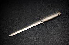 Punhal de prata no couro preto Imagens de Stock