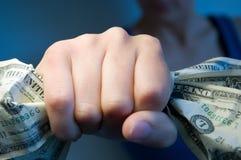 Punho completamente de dólares americanos Imagens de Stock