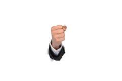 Punho da mão do homem de negócios que quebra através da parede de papel Imagem de Stock Royalty Free