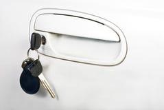 Punho e chaves de porta do carro Fotos de Stock