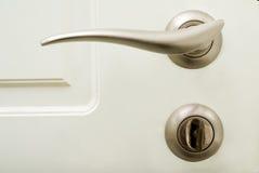 Punho e fechamento de porta com chave imagem de stock royalty free
