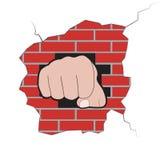 Punho estourado através da parede de tijolo Imagem de Stock