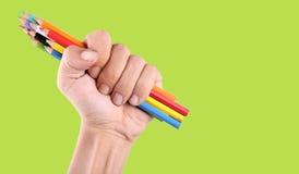 Punho que guarda lápis da coloração foto de stock royalty free