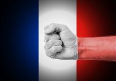 Punho sobre a bandeira de França Fotos de Stock Royalty Free