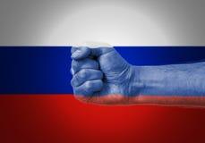 Punho sobre a bandeira de Rússia Imagens de Stock
