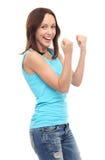 Punhos de aperto felizes da jovem mulher Imagens de Stock