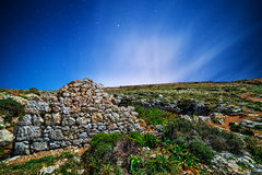 Punic Wall. Remains of a Punic wall at Ghajn Tuta Cave in Mellieha in Malta, shot by moonlight royalty free stock photography
