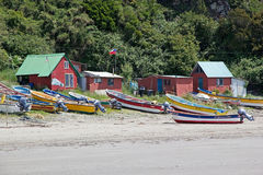 Punihuil beach, Chiloe island, Chile. Punihuil beach with boats and houses in the northwestern cost of Greater Island of Chiloe, Chile. Punihuil is a cove with a stock photography