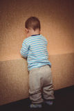 Punished a child standing at the wall Royalty Free Stock Photo