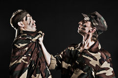 Punishment in army. Studio shot over black background Stock Photography