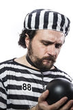 Punishment, one caucasian man prisoner. Criminal with chain ball and handcuffs in studio isolated on white background Royalty Free Stock Image