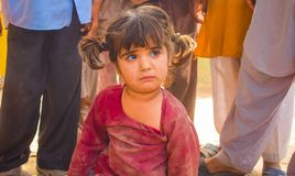 Punjab,Pakistan-April 14,2019:close up of a pakistani little girl sitting on earth looking unhappy royalty free stock photos