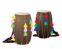 Punjabi drums. An illustration of two punjabi drums called dhols with colorful decorations on a white background Stock Image