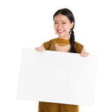 Punjabi girl holding blank white paper card. Portrait of young mixed race Indian Chinese female in traditional punjabi dress holding a blank white paper card Stock Photo