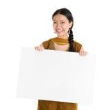 Punjabi girl holding blank white paper card. Stock Photo