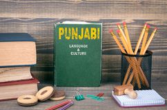 Punjabi language and culture. Concept. Book on a wooden background stock photo