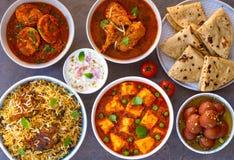 Punjabi non vegetarian main course. Punjabi party menu consisting of chicken biryani, gulabjamun dessert ,roti flatbread, boondi raita ,amritsari fish curry royalty free stock images