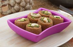 Punjabi Pinni. Pinni is a type of Punjabi and North Indian cuisine dish that is eaten mostly in winters. It is served as a dessert and is made from desi ghee Stock Photos