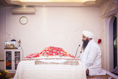 Punjabi Priests in Gurdwara Stock Photography