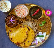 Punjabi vegetarian thaali meals served traditionally in brass plate. Traditional Indian vegetarian main course from North Indian state of Punjab and delhi served stock photography