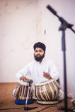 Punjabimusicus het spelen duggi stock foto's