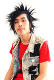 Punk. Portrait of a young Asian punk isolated royalty free stock images