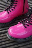 Punk alternative girl or woman boots - pink shoes stock images