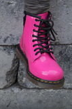 Punk alternative girl or woman boots - pink shoes royalty free stock photography