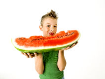 Punk boy eating a big slice of watermelon Stock Photography