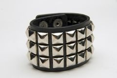 Punk bracelet. Punk rock wristband royalty free stock images