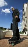 Punk Businessman on Skateboard Royalty Free Stock Photo