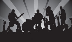 Punk Concert. Punker silhouettes that include singer, guitarist, bassist, drummer and fans Royalty Free Stock Photos