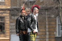 Punk fashion. Is the clothing, hairstyles, cosmetics, jewelry, and body modifications of the punk subculture. Contemporary street punks wear leather, denim Royalty Free Stock Photos