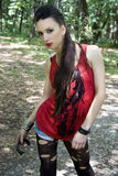 Punk music fashion. Beautiful girl in punk and rock inspired outfit Royalty Free Stock Image