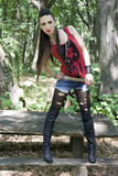 Punk fashion. Beautiful girl in punk and rock inspired outfit Royalty Free Stock Photo