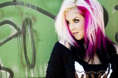 Punk Fashion Model. Punk Goth Fashion model against a graffiti background royalty free stock images