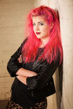 Punk Female Leaning Against Wall Stock Image