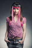 Punk Girl. Portrait of a young punk girl with a nice hair cut in pink Stock Images