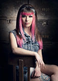 Punk Girl. Portrait of a young punk girl with a nice hair cut in pink Royalty Free Stock Photos