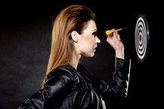 Punk girl with dart and target Royalty Free Stock Photo
