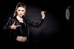 Punk girl with dart and target Royalty Free Stock Images