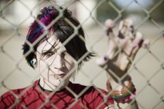 Punk Girl Behind Chain Link Royalty Free Stock Image