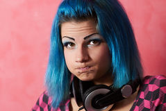 Punk girl DJ with dyed turqouise hair Stock Photo