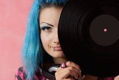 Punk girl DJ with dyed turqouise hair Stock Images