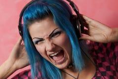 Punk girl DJ with dyed turqouise hair Royalty Free Stock Image