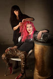 Punk Girl with Hair Stylist. Young punk rocker leaning back with hair stylist working Stock Image