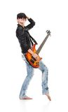 Punk girl holding a guitar and singing. Isolated on white stock images