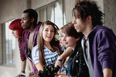 Punk girl looks to camera and poses among friends Royalty Free Stock Images